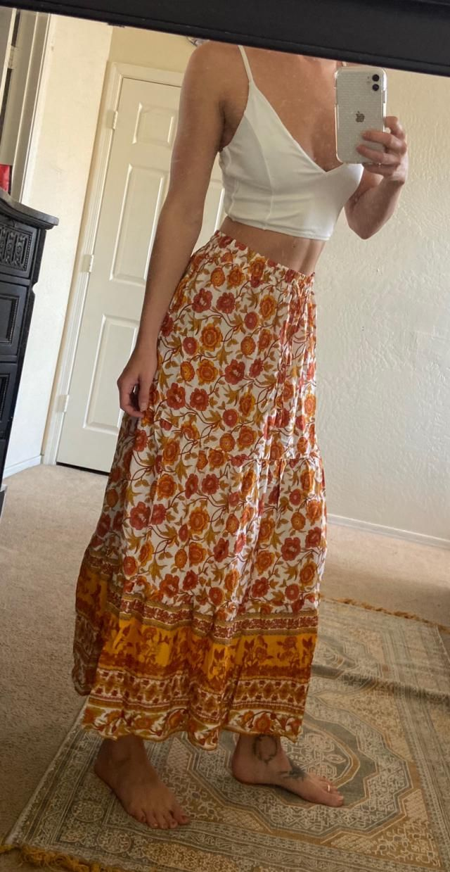 Seriously love this skirt and the pattern on it. Material is pretty thin and it's a bit shorter than I thought it woul…