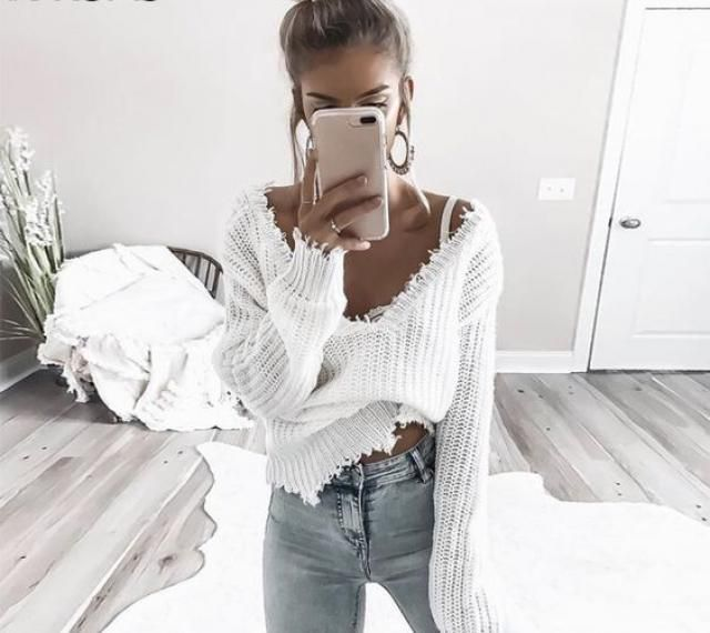 Loose Ripped V Neck Sweater I love this sweater!! It's super cute!
