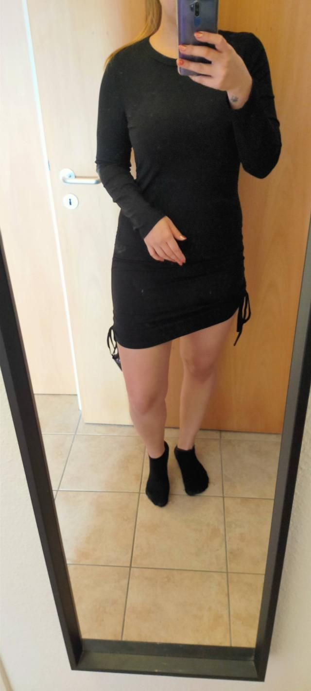 Very cute basic dress. Nice material, not see through. It doesn't give shape. I was afraid it would be too short, but …