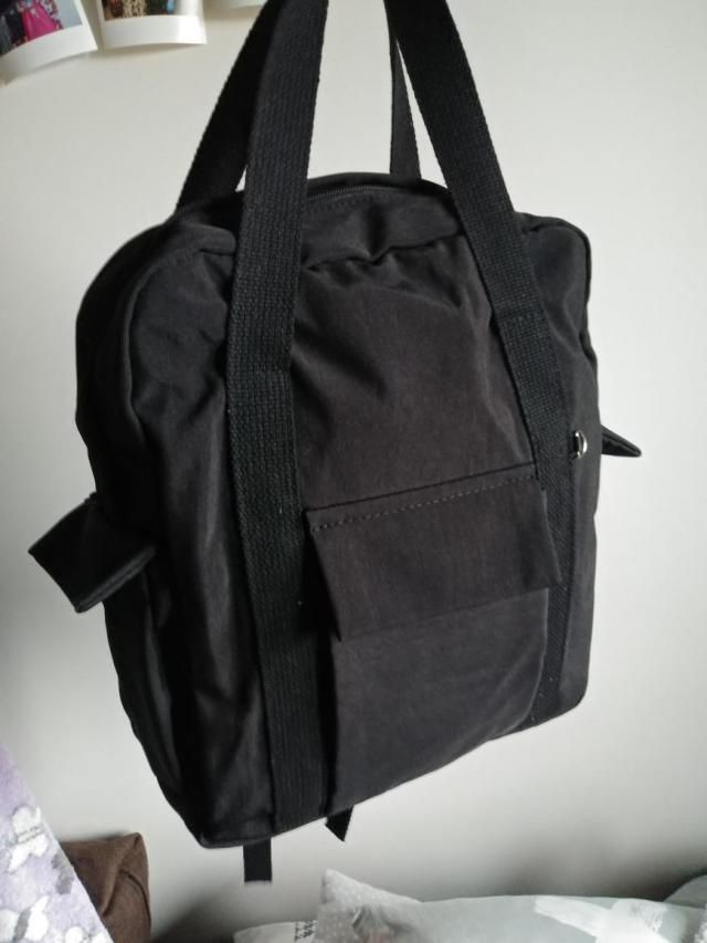 I love this backpack, it's kind of unique, looks like on the picture I really like these long handles on the topDefini…