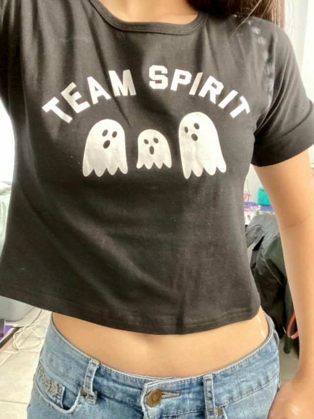 Super happy to have this shirt for spooky season! It's so cute! The material is nice, more form fitting that I thought…