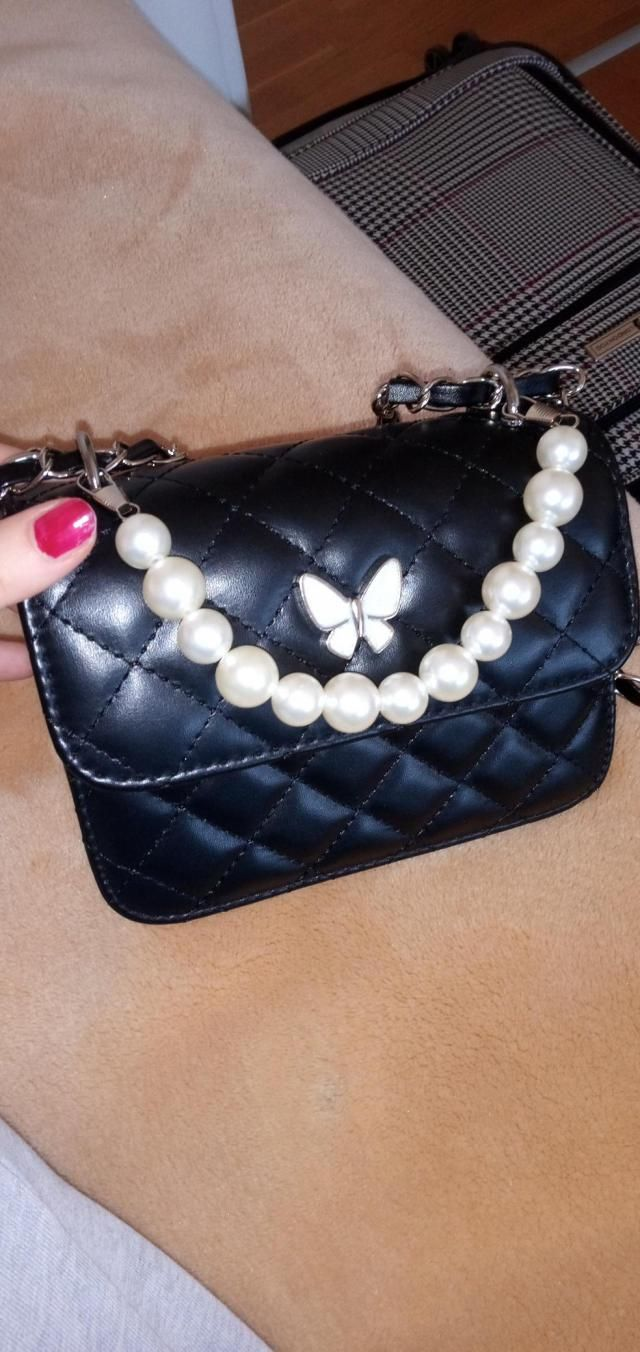 Very cute.  Very comfortable to wear, great material. The pearl strap is shorter than it seems on the pictures, you ca…