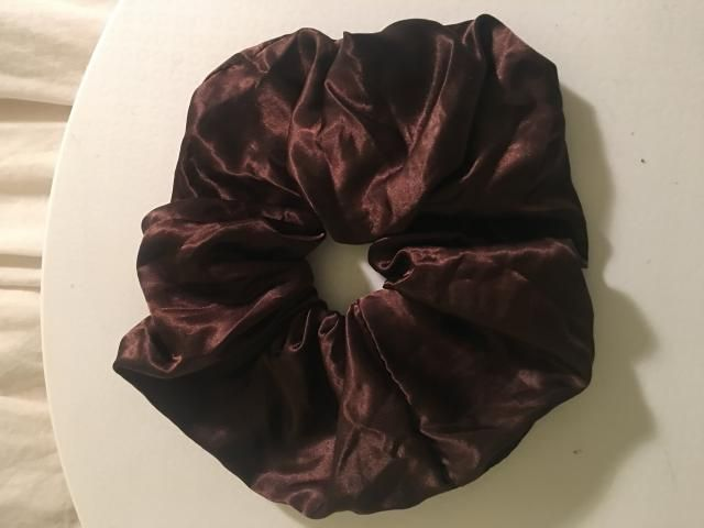 My favourite scrunchie! It is satin and jumbo so it makes the perfect accent in hair. Looks great tied up in a casual …