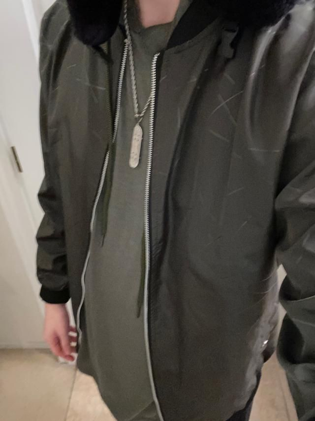 True to size and fits well and it honestly looks BETTER Than the picture, I love this jacket! So worth the money.