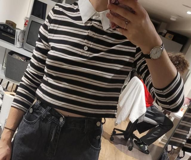Bought a size L, which is still sort of small on me but its one of my favorite shirts to wear. Great with high waisted…