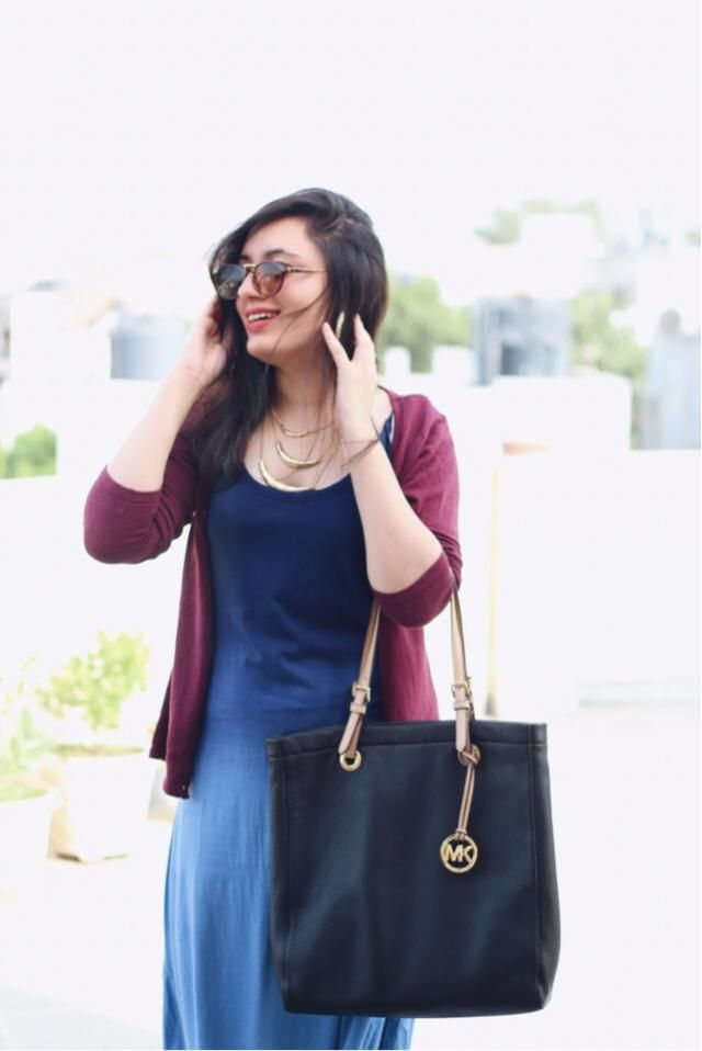 A long dress with a cardigan is perect for a casual lunch date.