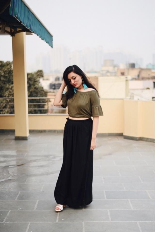 Flirtatious off shoulder top with a long black skirt and feather earrings is what ai wore for my Valentine&;s Day.