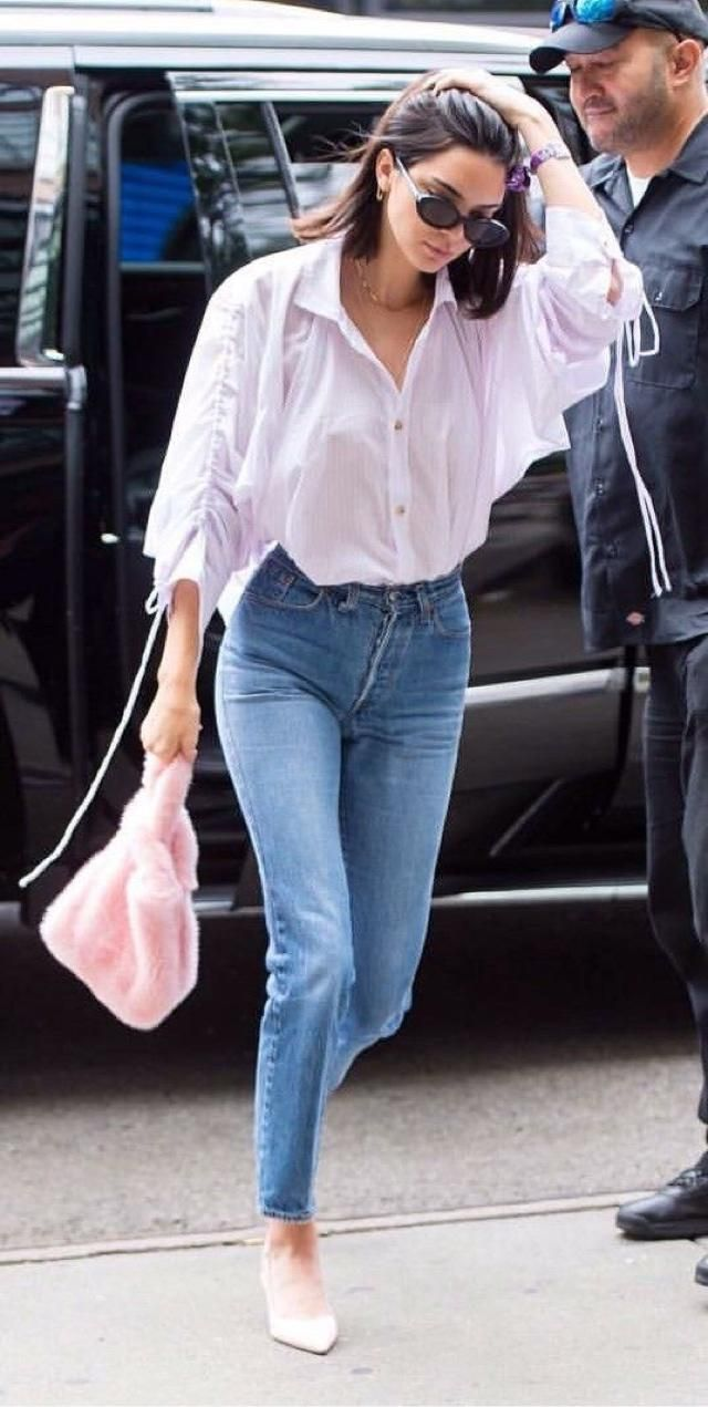 White shirt making perfect combination get with blue jeans. Looks casual and elegant.