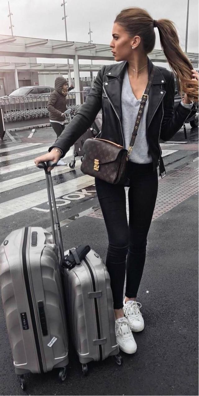 Black jeans + Classic leather jacket + Sneakers- essential for comfort airport look!