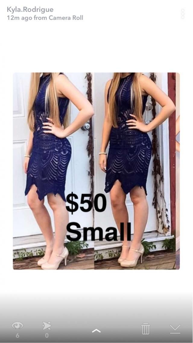 Navy blue and tan dress. Worn once. Fitted. No rips. Willing to drop price just make an offer. Thanks!