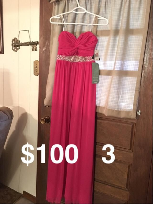 Pink prom dress. Worn once. No rips. Willing to drop price just make an offer. Thanks!
