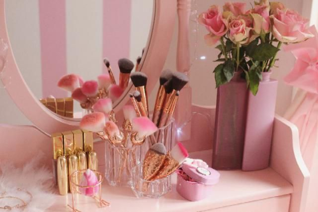 I love rosegold makeup brushes on my pink vanity.