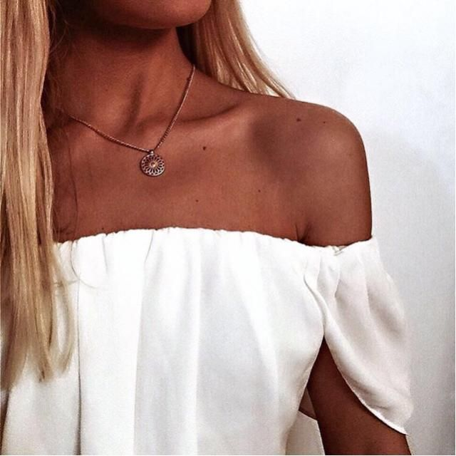 Tan skin with white off the shoulder blouse, yay or nay?
