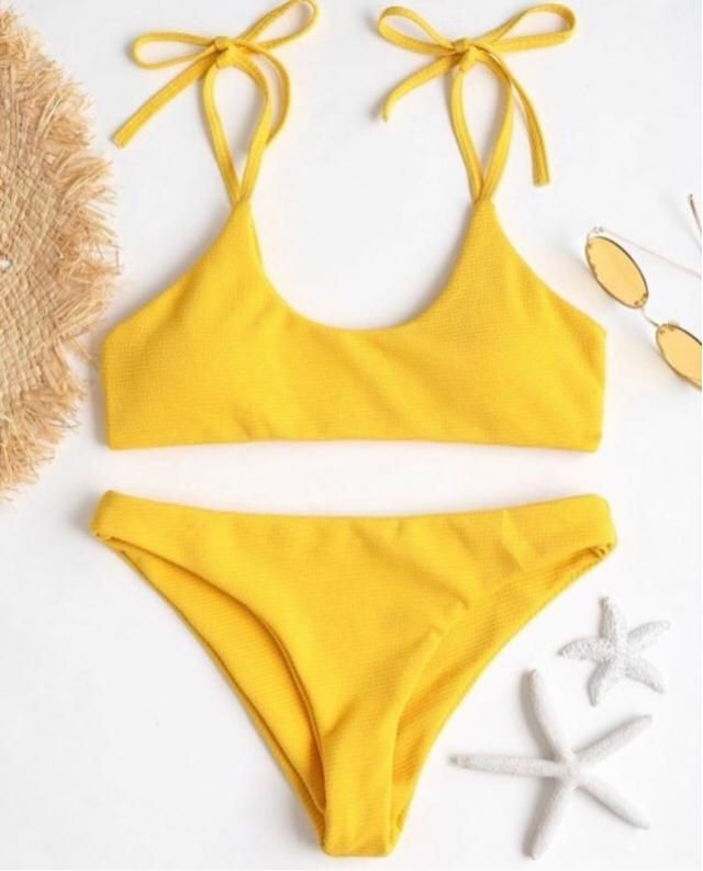 Purchased this bikini. A little more of a mustard yellow than a bright yellow. But still really gorgeous and great qual…