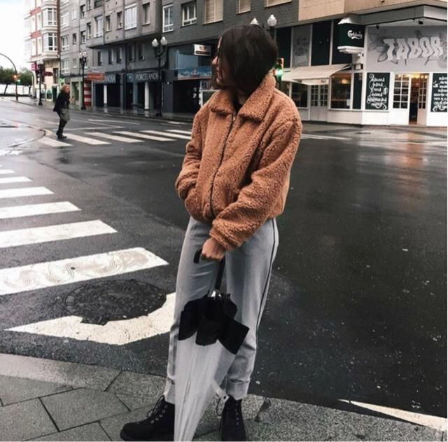 Never forget cozy fur jacket with umbrellas, cause it's cold and often raining