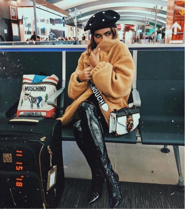At airport and absolutely it's cold, this fur jacket will keep you warm anywhere everywhere