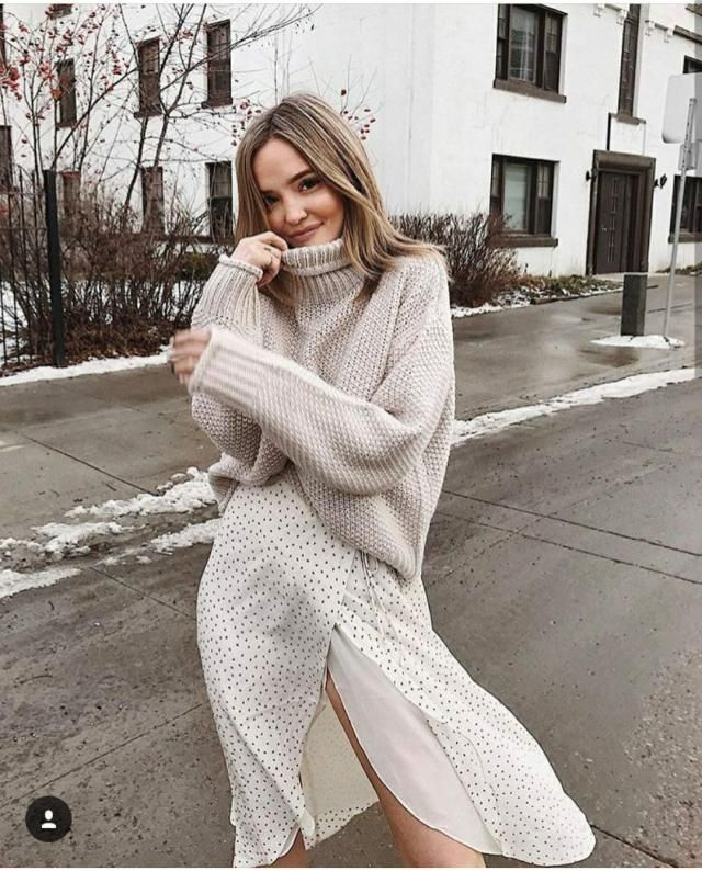 I simply adore wearing chunky sweaters on a skirt or a dress. Looks really cool.