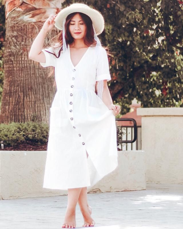 Love this white button up maxi! The material is thick but still flows very nicely. The button is just so cute! I pa…