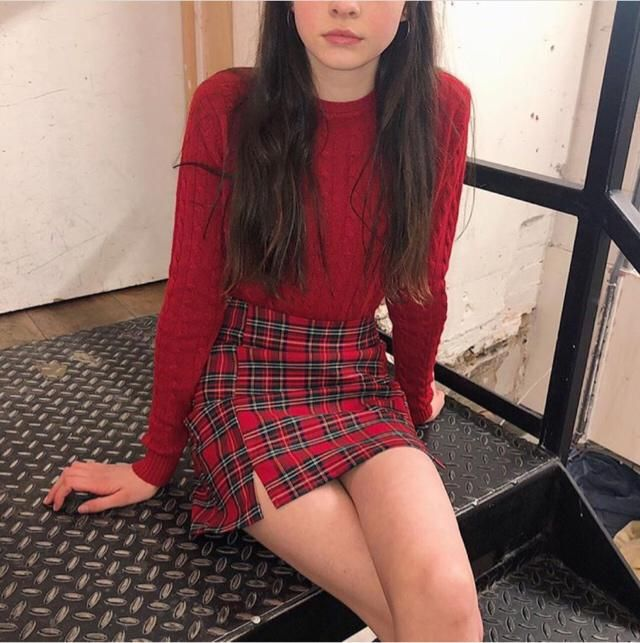 Cute red outfit, including red and green plaid skirt and red long sleeve shirt :)