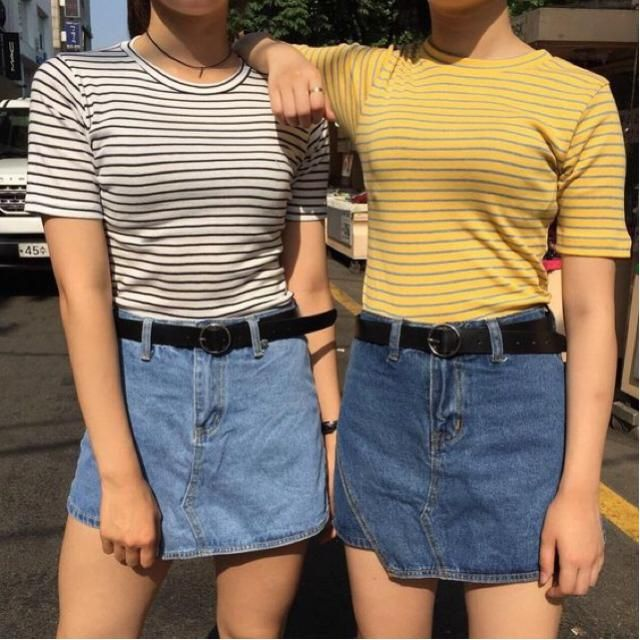 Friend outfits both including a denim skirt and a striped t shirt :)