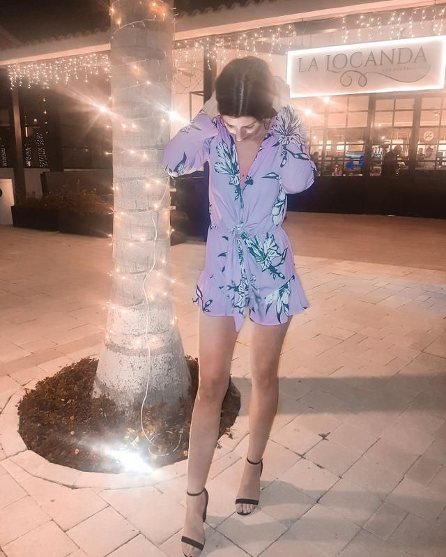 This floral light purple romper will be the life of any party. Dress it up with a pair of black heels and a pair of sil…
