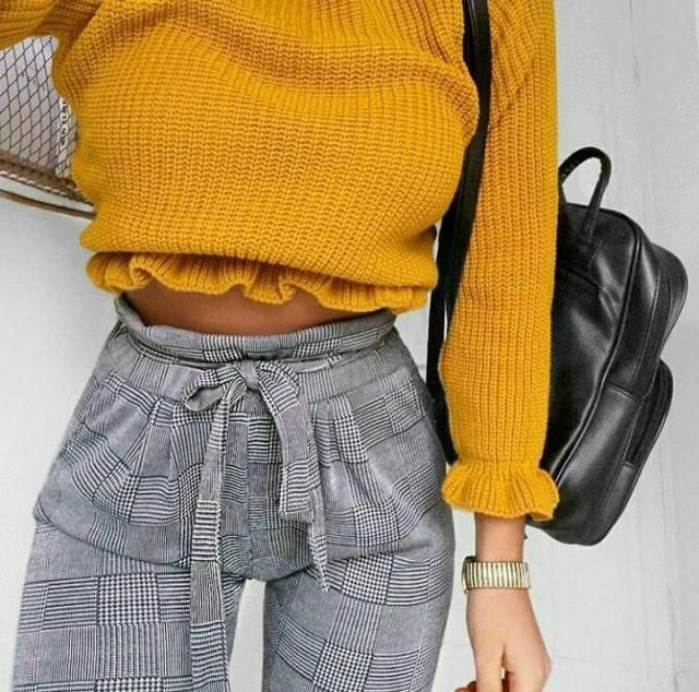 A must-have for the girl who likes to make a statement while being comfortable, a basic yellow sweater with chec…