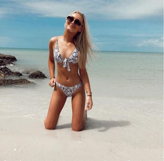 LOVE. this snake print bikini looks so nice on any tropical vacation! And these Sunnies compliment it perfectly!…
