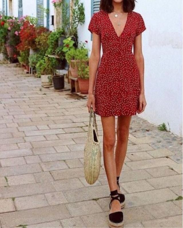 cute and trendy dress styled with a fashionable bag
