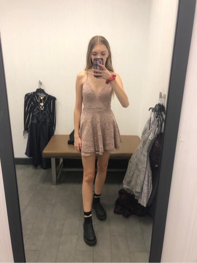 trying on formal dresses