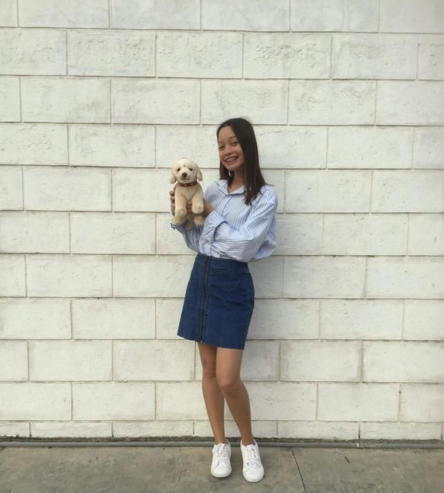 Another simple basic outfit inspired from korean fashion is striped oversized polo, blue denim skirt and white sn…