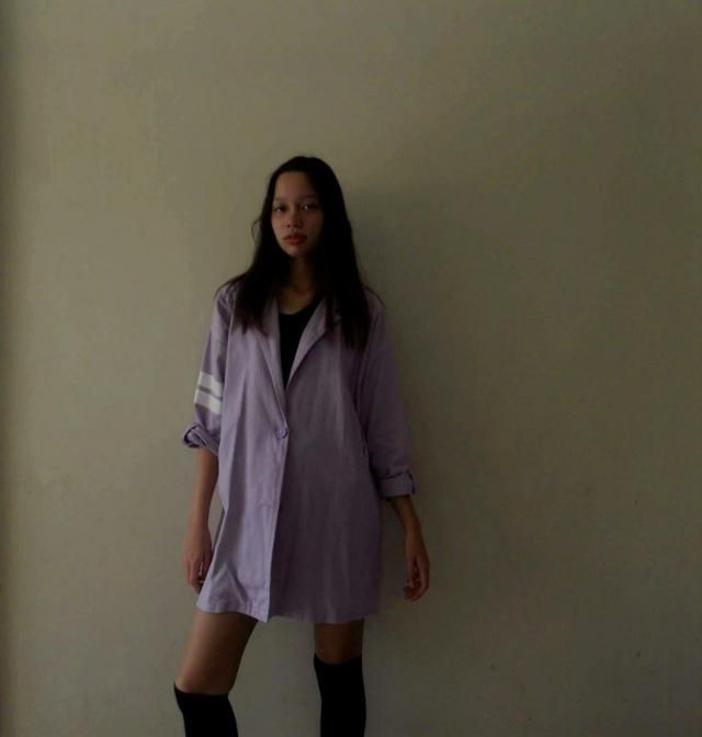 Another way of styling the pastel purple denim jacket is wearing it like a dress with black knee high socks and co…