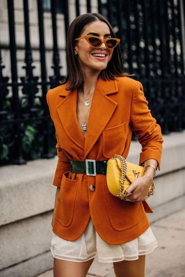 That orange coat looks so good with the yellow bag . Gemini style inspired