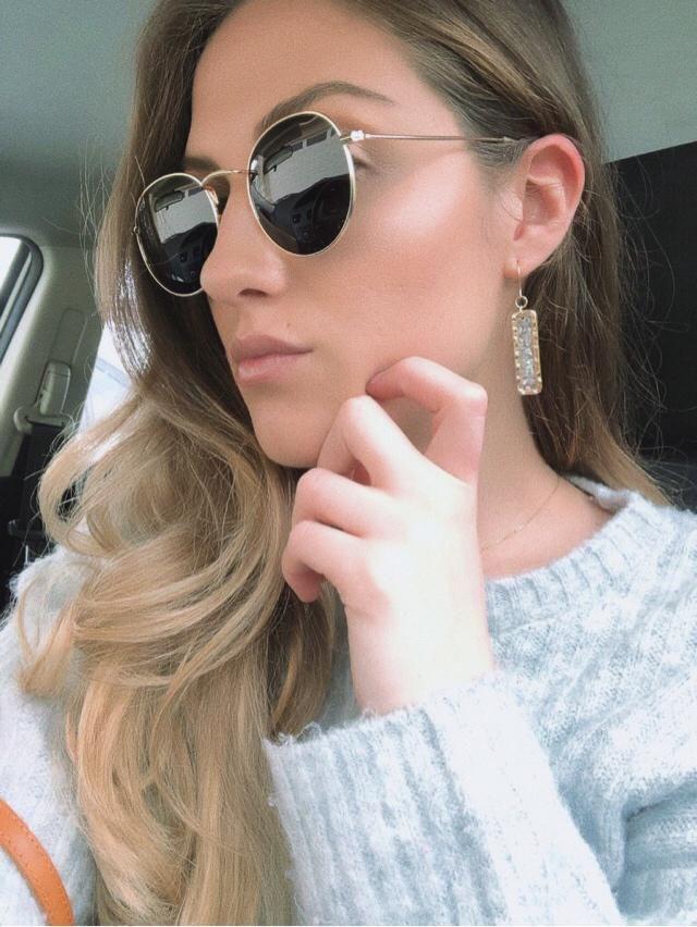 Soft sweater & delicate earrings