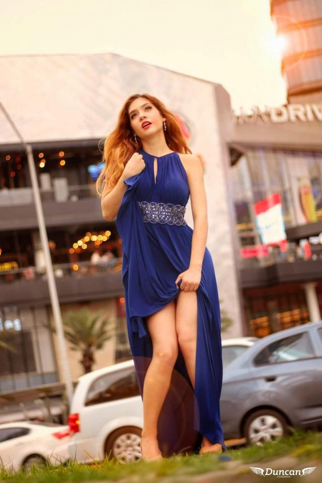 This blue dress is very elegant and smooth. I love the sparkles with silver rocks ar…