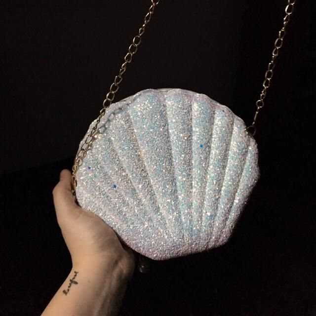 It looks prettier in the photos! The bag is kinda rough in texture, the glitters come off a little bit and the red clot…