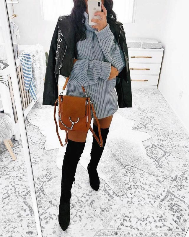 To achieve this look you need a faux leather jacket a turtleneck sweater dress and some cute long boots