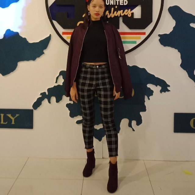 Black and white plaid pants would go well with ny color. I paired the pants with a turtleneck top, maroon/magenta jacke…