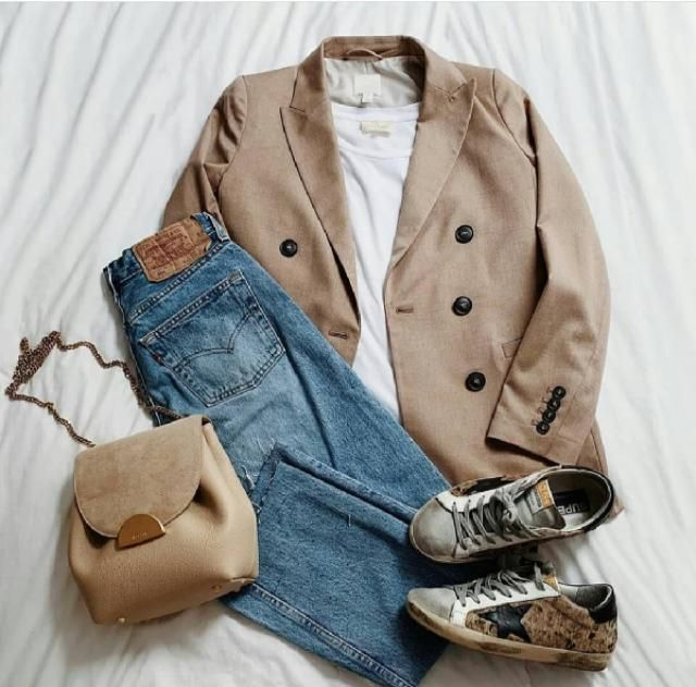 Dress up a fashionable pair ofstraight leg jeansby wearing them with a boyfriend-style blazer in black. Wear with…