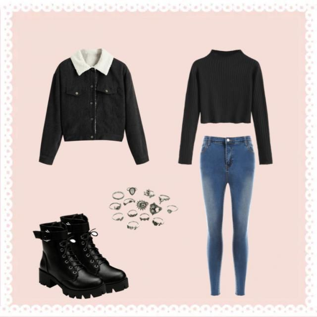 Black sweater, blue jeans, black jacket, boots and earrings.