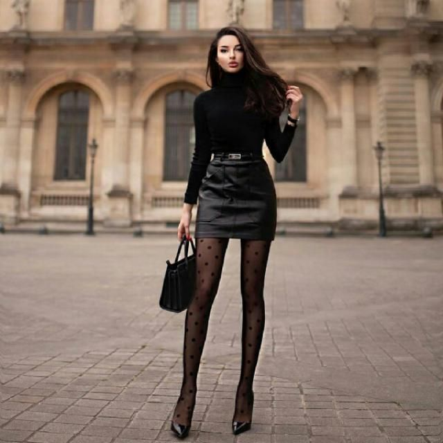 you can't go wrong with a black turtleneck and faux leather skirt