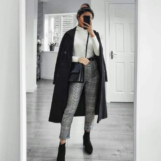 Keep it chic and classy with this black coat sweater over a white turtleneck and plaid pants