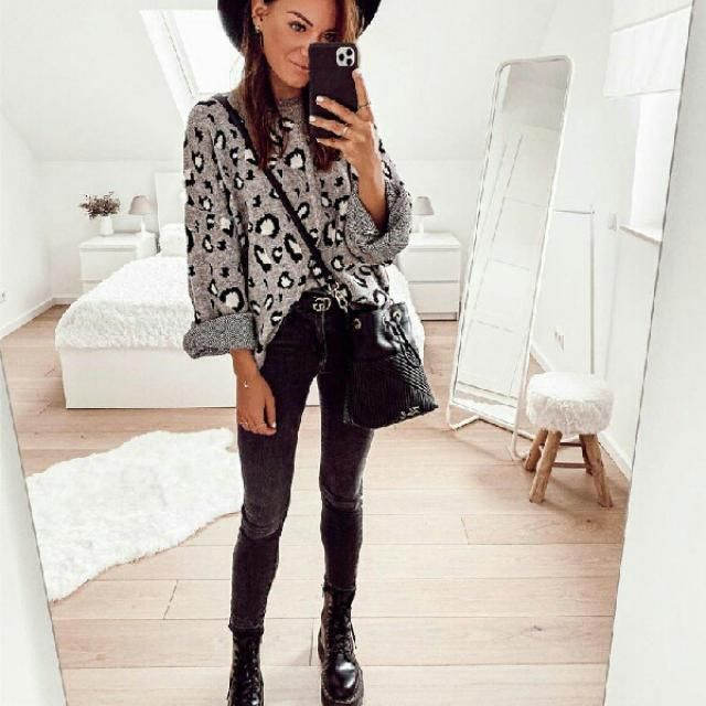 she looks chic and stylish in this leopard sweater and  faux leather pants