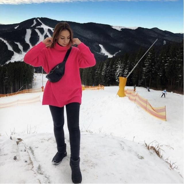 Loving the snow and having a good time with this pink sweater