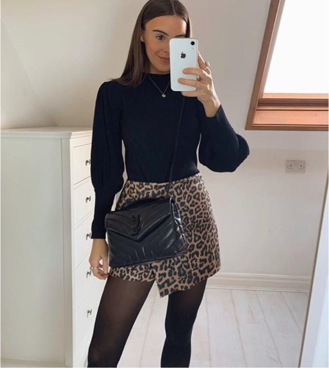 The leopard skirt and black sweater suit me alot