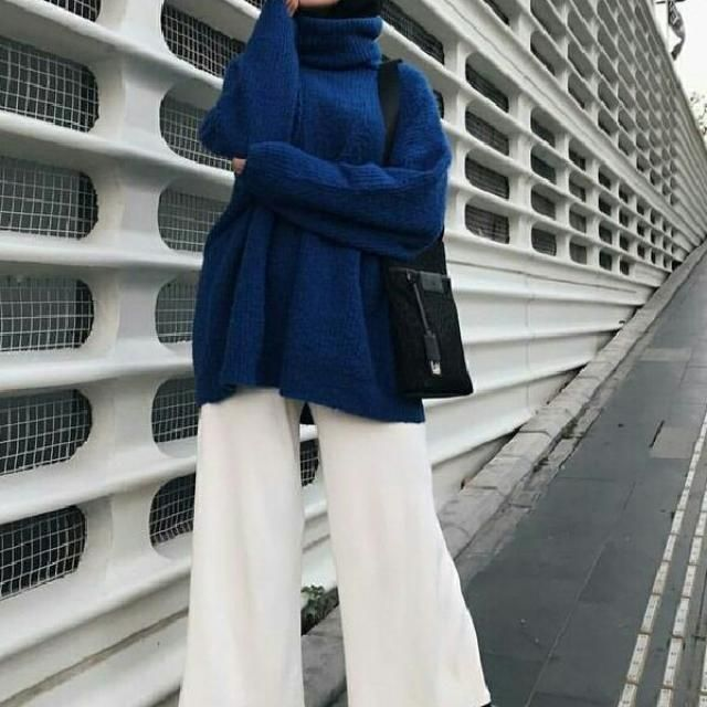 An oversized blue turtleneck sweater can be an ideal match for wearing with white simple pants and black pointed  …