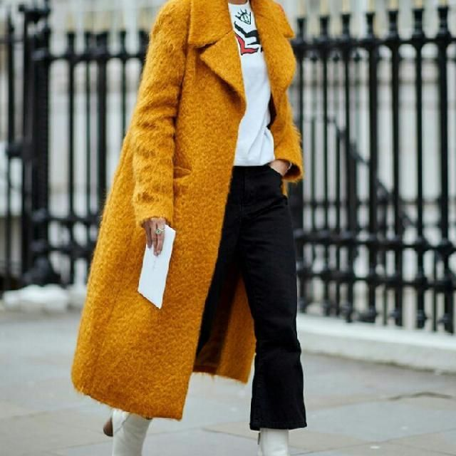 A great way to make this simple look more chic and unique is to wear this yellow long coat