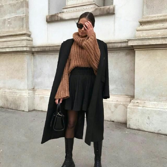 Update your casual everyday look by wearing a black long coat over a turtleneck khaki sweater with a black skirt…