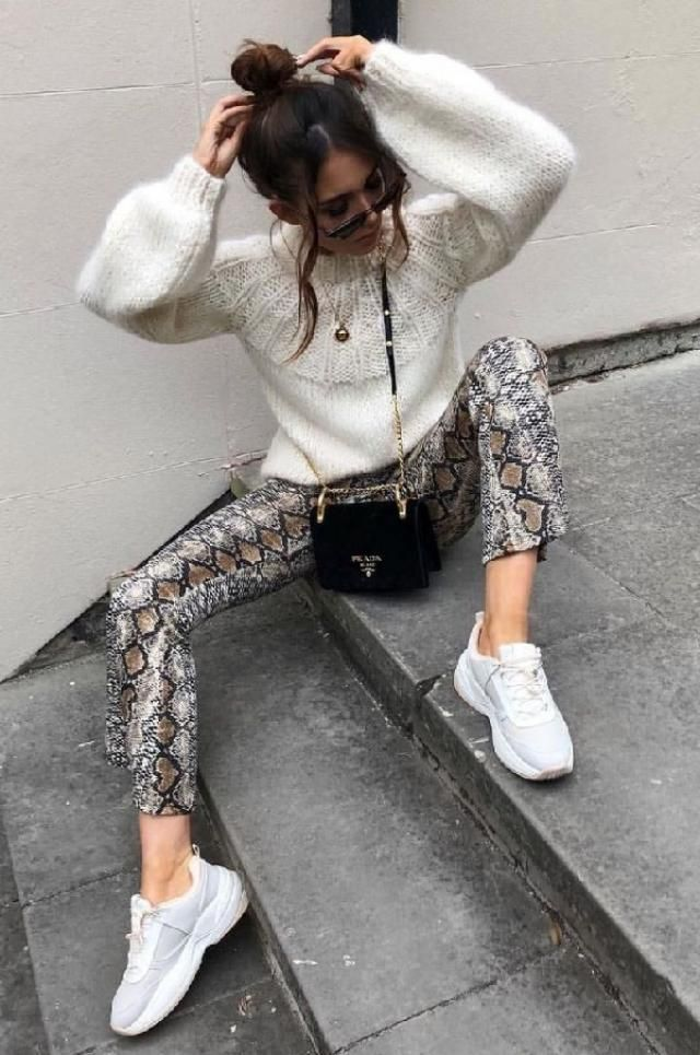 Combine your puff sleeve sweater with snake print pants and make your outfit look awesome | | |
