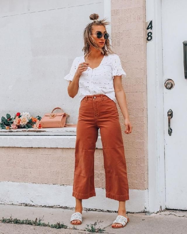 This casual combo of an eyelet blouse and corduroy pants can only be described as seriously chic. Slide sandals ar…