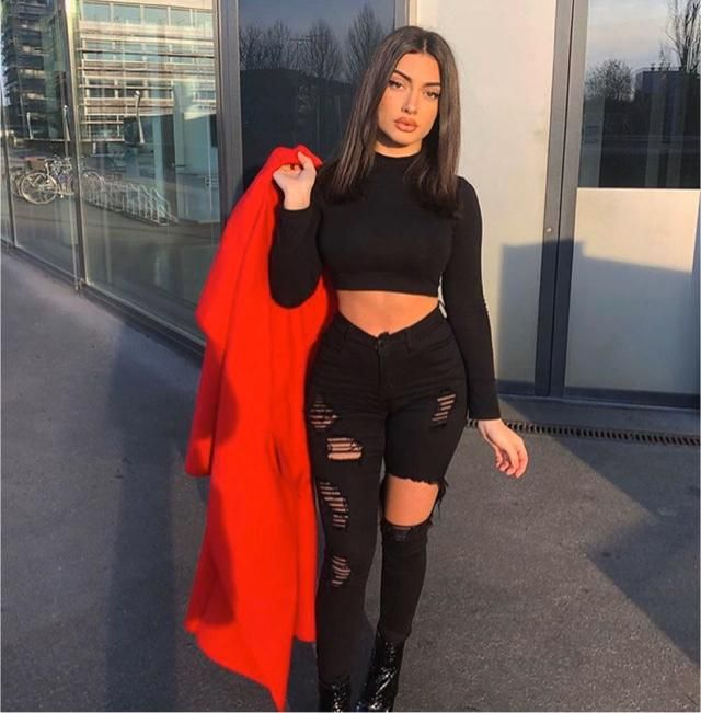 This black outfit will look more glamorous with the red coat